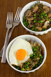 Fried egg with peas with mushrooms Stock Images