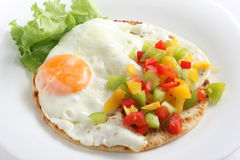 Fried egg with pepper Royalty Free Stock Image