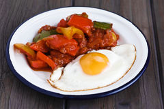 Fried egg with pepper vegetables Stock Photography