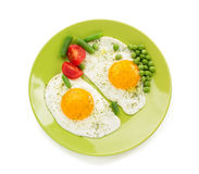 Fried egg in plate isolated on white Royalty Free Stock Photo