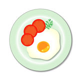 A fried egg on a plate Stock Photo