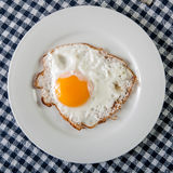 Fried egg on plate Stock Photo