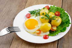 Fried egg with potato Stock Photo