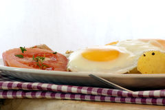 Fried egg with potato and bacon Royalty Free Stock Photography
