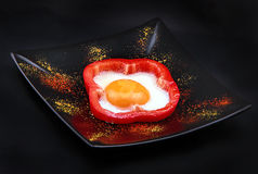 Fried egg in red pepper Royalty Free Stock Image