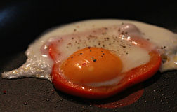 Fried Egg with Red Pepper Stock Photos