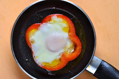 Fried egg with red pepper Royalty Free Stock Photo