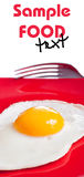 Fried egg on red plate Stock Image