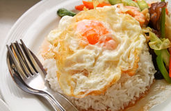A fried egg on rice. Royalty Free Stock Photos