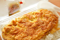 Fried egg on rice in foam box with plastic spoon ready for eat Stock Images