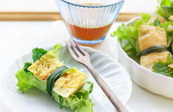 Fried egg rolled with fresh vegetable - cuon hanh Royalty Free Stock Images