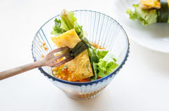 Fried egg rolled with fresh vegetable - cuon hanh Royalty Free Stock Photos