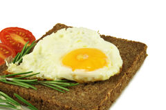 Fried egg on rye bread Stock Photography