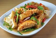 Fried egg salad on plate Stock Image