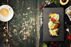 Fried egg sandwich: quail eggs, avocado and cheese on whole whea Stock Images