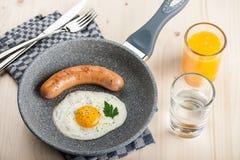 Fried egg and sausage Stock Image