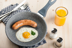 Fried egg and sausage Stock Photos