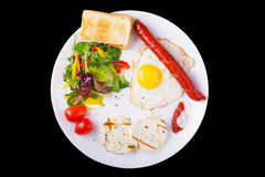 Fried egg and sausage Stock Images