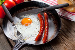 Fried egg. Fried egg with sausages in a pan Royalty Free Stock Photos