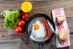 Fried egg. Fried egg with sausages in a pan Royalty Free Stock Images