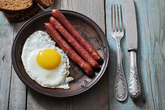 Fried egg with sausages Stock Photos