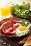 Fried egg sausages tomatoes for healthy breakfast Royalty Free Stock Photo