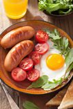 Fried egg sausages tomatoes Royalty Free Stock Image