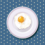 Fried egg served on a laver plate and on sea blue tablecloth Royalty Free Stock Photo