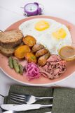 Fried egg served with pastrami royalty free stock photo