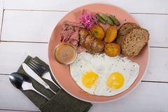 Fried egg served with pastrami stock photography