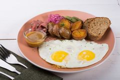 Fried egg served with pastrami royalty free stock image