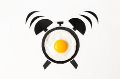 Fried egg in shape of alarm clock, breakfast time concept Stock Images