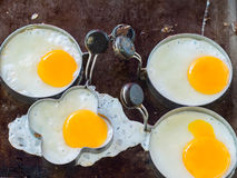 Fried egg in shape form Stock Images