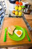 Fried egg in the shape of heart Stock Images