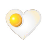Fried egg in a shape of heart on white background. Fried egg in a shape of heart Royalty Free Stock Photography