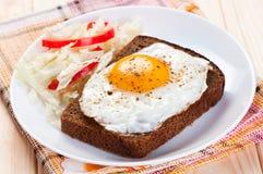 Fried egg on slice bread. Stock Images