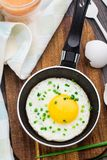 Fried egg in a small pan Stock Photography