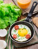 Fried egg in a small pan Stock Images