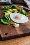 Fried egg with spinach, avocado and hummus Royalty Free Stock Image