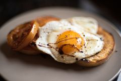 Free Fried Egg Sunny Side Up On A Toast With Tomato Stock Image - 99735191
