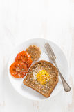 Fried egg in a toast with grilled tomatoes for breakfast Royalty Free Stock Photography