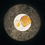 Fried egg and toast on plate. Stock Photos
