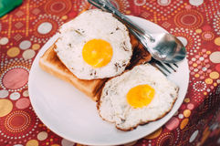 Fried Egg with toast. On plate Stock Image