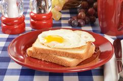 Fried egg on toast Stock Photos