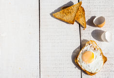 Fried egg on toast, snack, breakfast, white background Royalty Free Stock Photography