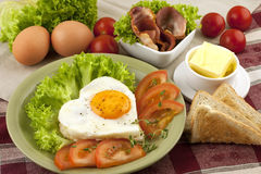 Fried egg, tomato and bacon Stock Image