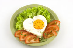 Fried egg, tomato and Royalty Free Stock Images