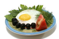 Fried egg with tomato on dish Royalty Free Stock Photos