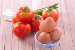 Fried egg with tomato recipe Stock Images