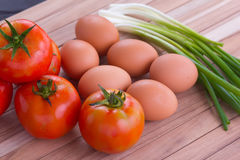 Fried egg with tomato recipe Royalty Free Stock Photo